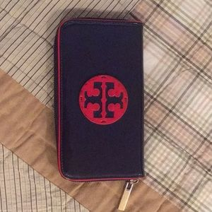 Tory Burch wallet with red trim.